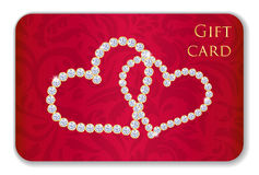 Red Valentine gift card with entwined hearts compo. Luxury red Valentine gift card with entwined hearts composed from diamonds Stock Photos