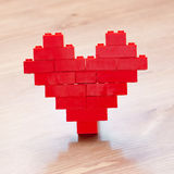 Red valentine heart. Giving with love Royalty Free Stock Photography