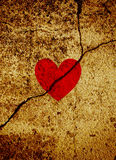 Red valentine heart on cracked grunge background Royalty Free Stock Photo