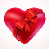 Red Valentine Heart gift with Bow and tape. Stock Photo