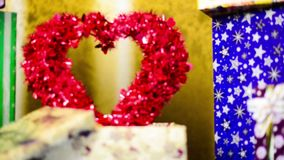 Red valentine heart inside gift box. Red big decorated heart inside present cox at colorful background stock video
