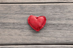 Red valentine heart symbol on wood background Royalty Free Stock Image