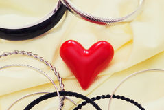 Red valentine heart with various bracelets Stock Images