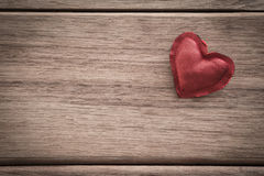 Red valentine heart on wood background with space for text Royalty Free Stock Photo