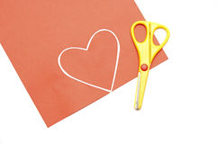 Red valentine heart and yellow scissor Stock Photo