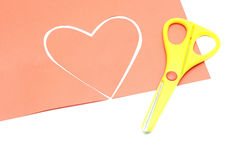 Red valentine heart and yellow scissor Royalty Free Stock Image