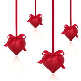Red Valentine Hearts. Valentine heart decorations with red ribbon and bows, isolated over white background Stock Photo
