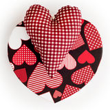 Red valentine hearts of fabric and cardboard. On a white background stock image