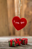 Red Valentine hearts on old rustic wooden background Royalty Free Stock Photography