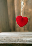 Red Valentine hearts on old rustic wooden background Royalty Free Stock Images