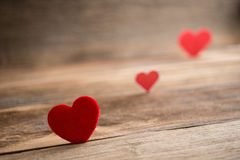Red Valentine hearts on old rustic wooden background Stock Photography