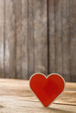 Red Valentine hearts on old rustic wooden background Stock Photo