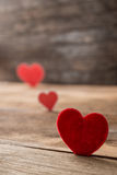 Red Valentine hearts on old rustic wooden background Royalty Free Stock Photo