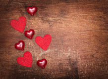 Red valentine hearts on old wooden background Royalty Free Stock Photo