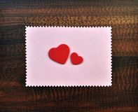 Red valentine hearts paper gift card on table Stock Photography