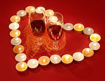Red Valentine's Day background. Red Romantic Valentine's Day composition with two glass of wine in the center of candle burn heart Royalty Free Stock Images