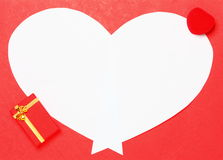 Red Valentine's Day background with heart and gift box Royalty Free Stock Photography