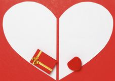 Red Valentine's Day background with heart and gift box Stock Photography