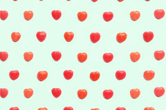 Red Valentine`s day heart candy pattern on green pastel paper color background. Love Concept. colorful hipster style. top view. Royalty Free Stock Photography