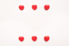 Red Valentine`s day heart shape candy pattern on empty white paper background. Love Concept. colorful hipster style. Knolling top Royalty Free Stock Images