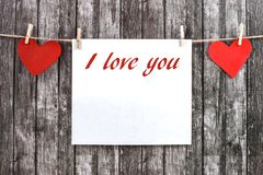 Valentine`s hearts with empty piece of paper. royalty free stock photography
