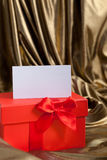 Red Valentines or Christmas gift with a blank tag Royalty Free Stock Photography