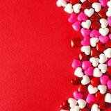 Red Valentines Day background with candy heart border Stock Image