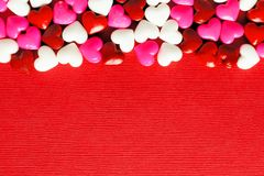 Red Valentines Day background with candy hearts Stock Photo