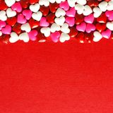 Red Valentines Day background with candy hearts Stock Photos