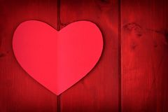 Red Valentines Day paper heart over a red wood background Royalty Free Stock Photos
