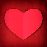 Red Valentines Day paper heart on red wood with vignette Stock Photography