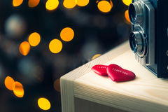 red valentines heart with old camera and bokeh Royalty Free Stock Photo