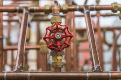 Red valve on copper pipe construction in outdoor. Red valve on copper pipe stock photography