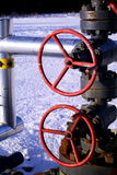 Red valve handles. A set of two red valve handles on a natural gs well head Stock Images