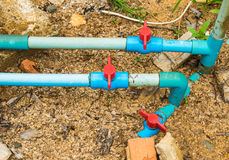 Red valve on water pipelines. Royalty Free Stock Photography