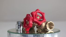 Red valve. Water tap rotating stock video footage