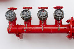 Red valves. Water pipe with a red valves Royalty Free Stock Images