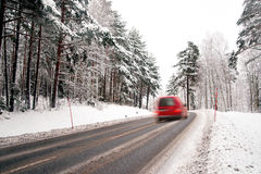 Red van on winter road Stock Photo