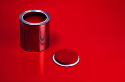Red Varnish Can. Opened can of red varnish, red background Royalty Free Stock Photo