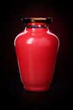 Red vase. On black background Stock Photography