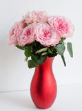 In red vase bouquet of pink garden roses. Roses in the red vase on the table, medium bouquet, big round shape fresh cut Stock Images
