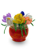 Red vase with flowers from glass beads and wire. Handmade article: vase with flowers from glass beads and wire. Yellow, blue, pink, white bud. Green foliage. Red Royalty Free Stock Photography