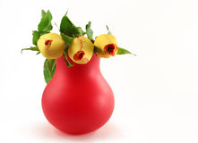 Red vase with roses. Red vase with yellow roses isolated on white Stock Image