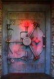 Red vault door. Red illuminated bank vault door stock photos