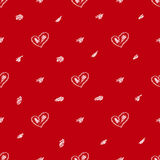 Red vector seamless background with hand-drawn hearts and spots. Royalty Free Stock Images