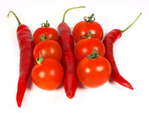 Red vegetables. Ripe tomatoes and chilli peppers isolated on white stock photos
