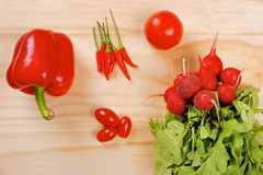 Red vegetables on a wooden background Stock Photography