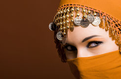 The red veil. A beautiful woman wearing a red exotic veil Stock Photos