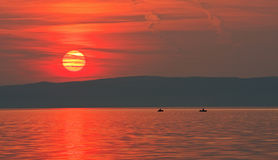 The Red Veil. Sunset at Lake Balaton with some fishing boats Stock Image