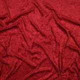 Red Velvet. Background with a wavy texture Royalty Free Stock Photography